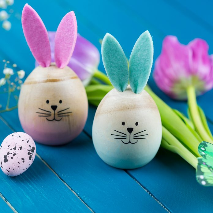 Two Painted Easter Eggs With Rabbit Ears