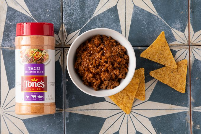 Tone's Taco Seasoning Prepared In Bowl With Chips And Seasoning Packet