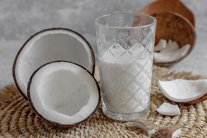 Opened Coconuts, Glass Of Homemade Coconut Milk And Coconut Chunks