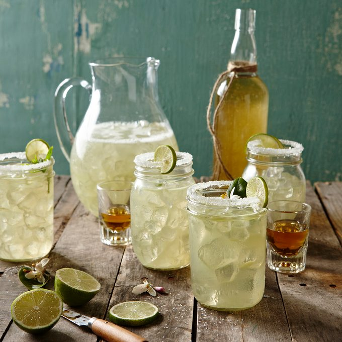 Margaritas in mason jars with shots of tequila