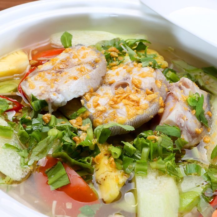 vietnamese recipes Sour Soup In Vietnamese Style With Grouper Fish In White Bowl