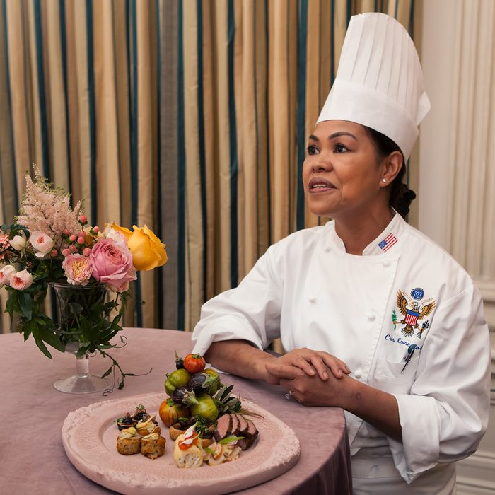 """White House Executive Chef Cristeta """"Cris"""" Comerford, speaks to press, showing a sample of the dinner that will be served at the Italy State Dinner, during a press preview in the State Dining Room of the White House. in Washington, DC, USA, on October 17th, 2016. (Photo by Cheriss May/NurPhoto via Getty Images)"""