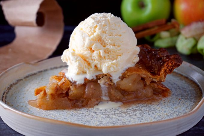 Apple Pie In A Bag slice of apple pie baked in a paper bag on a plate with ice cream