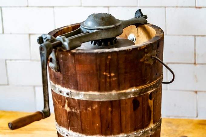 An Old Fashioned Ice Cream Maker With Turning Handle And Makers Mark