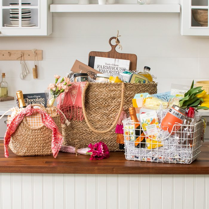 Gift baskets group; three gift baskets arranged on a kitchen counter