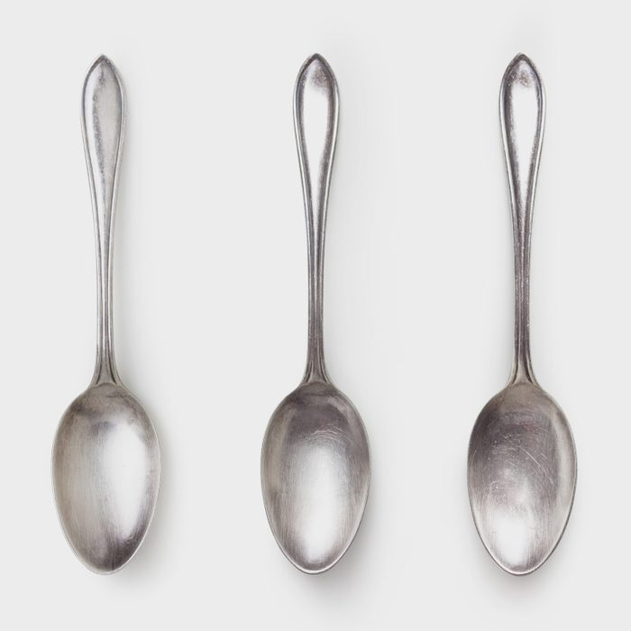 three spoons on white background shot from above