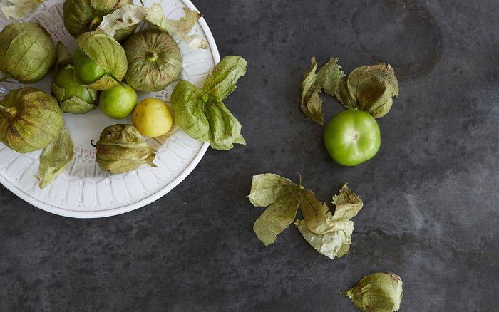 Fresh Tomatillos On A Plate And Zinc Metal Surface