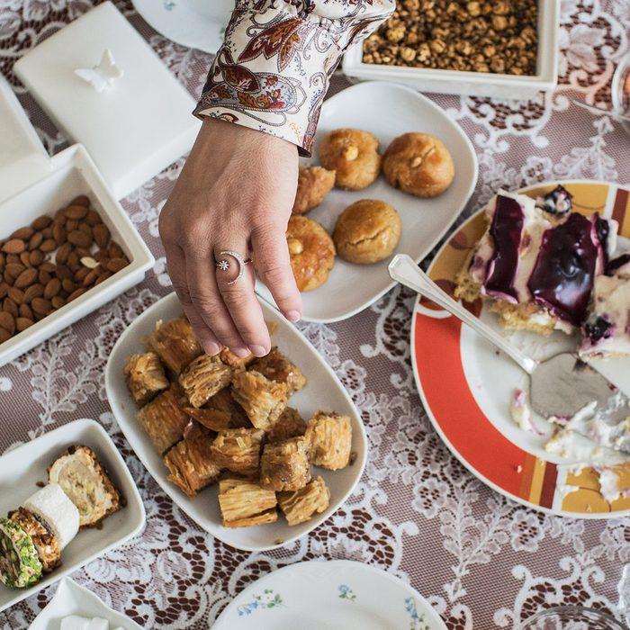 PRODUCTION - 13 May 2021, Lower Saxony, Hanover: Asse drinks tea with a friend and eats special sweets for Eid. For millions of Muslims, the holy fasting month of Ramadan ends with the Eid al-Fitr holiday on Thursday. This year, the so-called Eid is once again overshadowed by the Corona pandemic. Photo: Eman Helal/dpa (Photo by Eman Helal/picture alliance via Getty Images)