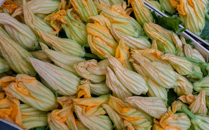 Zucchini flowers Naples, Italy October 23 2018 A box of fresh squash flowers in a local Italian market