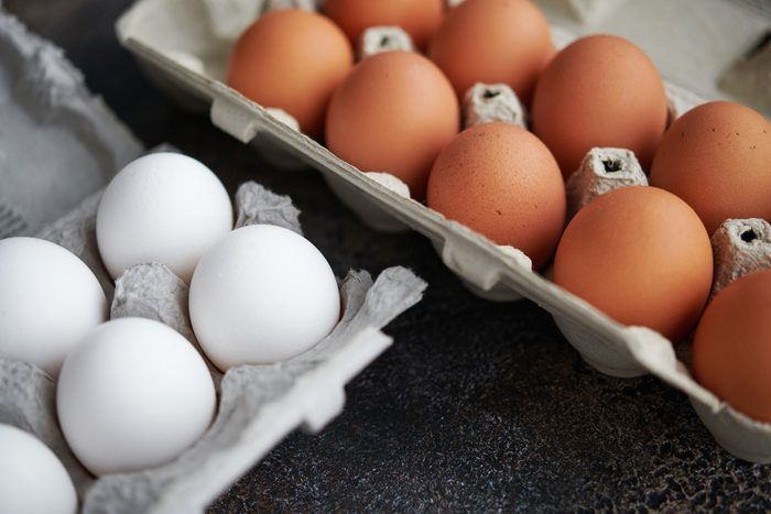 Showing Difference Between Brown and White Eggs in Carton