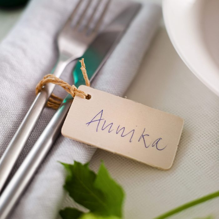 Cutlery on napkin with place card