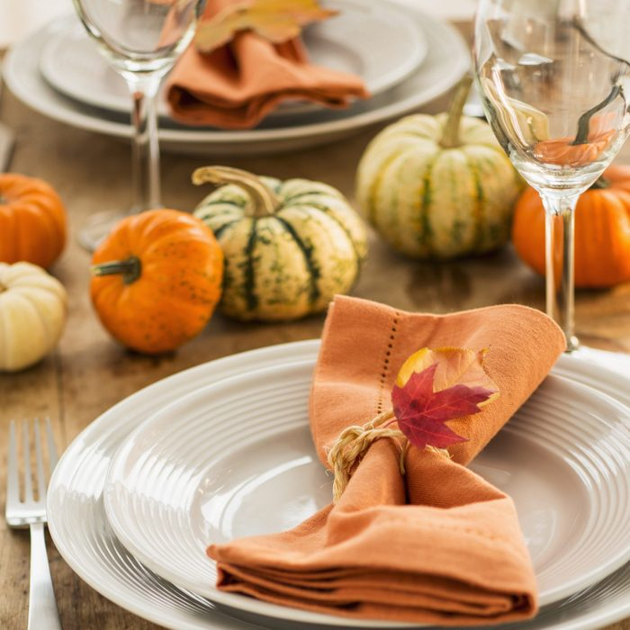 Table setting with small pumpkins