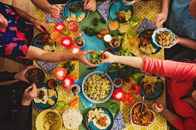 Friends having a Mexican tex mex dinner