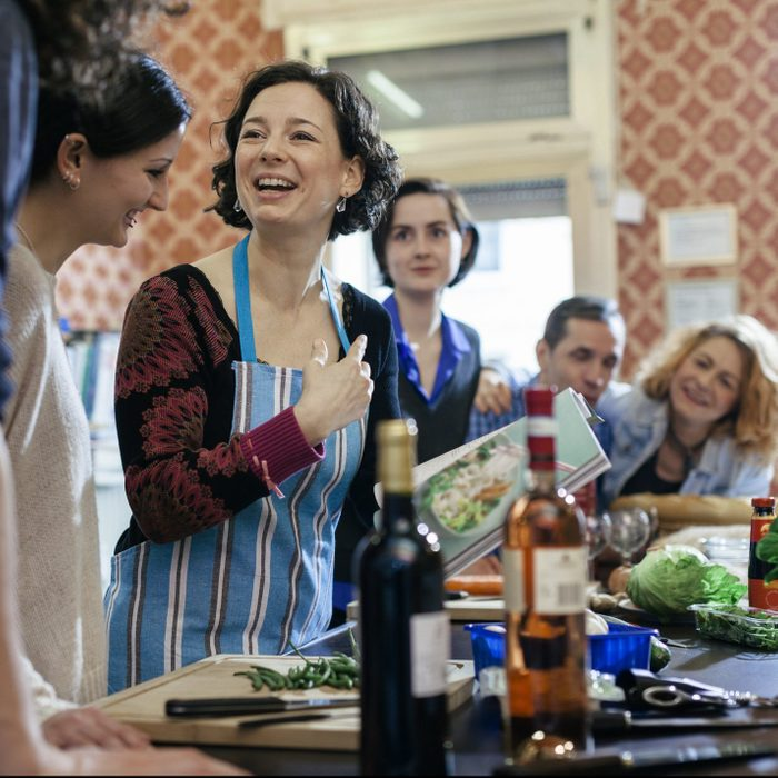 Cooking Instructor surrounded by curious students