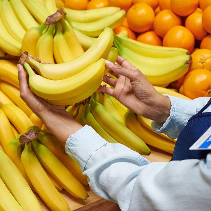 Walmart employee inspecting banana