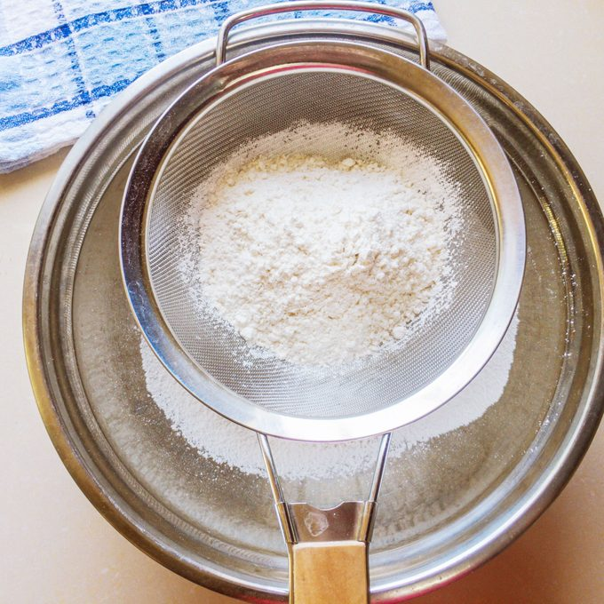 Sifting Flour for Jamaican Coco Bread
