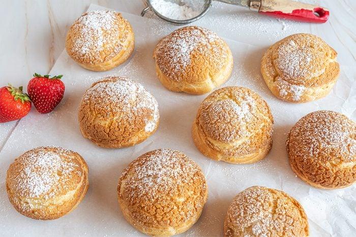 Choux Au Craquelin Vanilla Cream Puffs on marble countertop