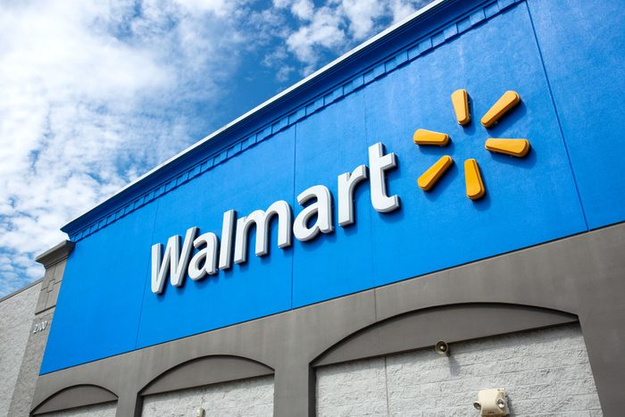 walmart logo on a store exterior on a sunny day