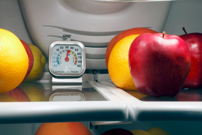 thermometer on a shelf in a refrigerator showing the ideal refrigerator temperature