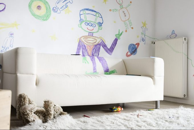 Child's Drawings On Wall In Living Room