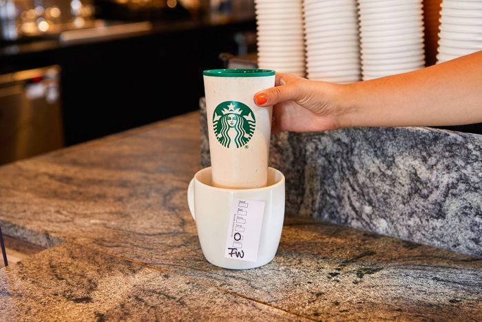 hand grabbing a Free Starbucks Coffee