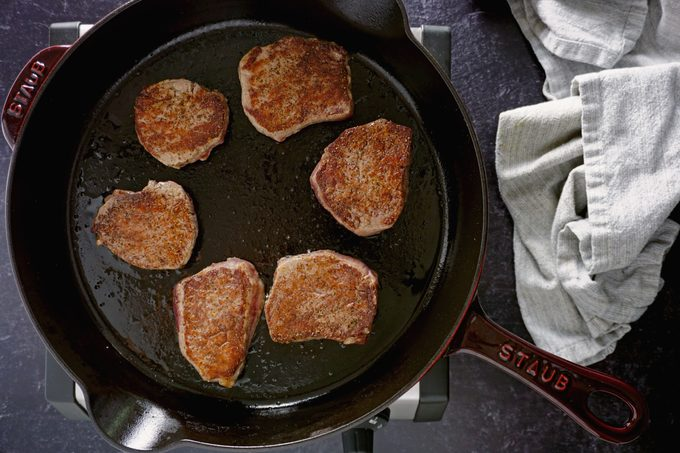 searing the steaks for Cheesecake Factory Steak Diane