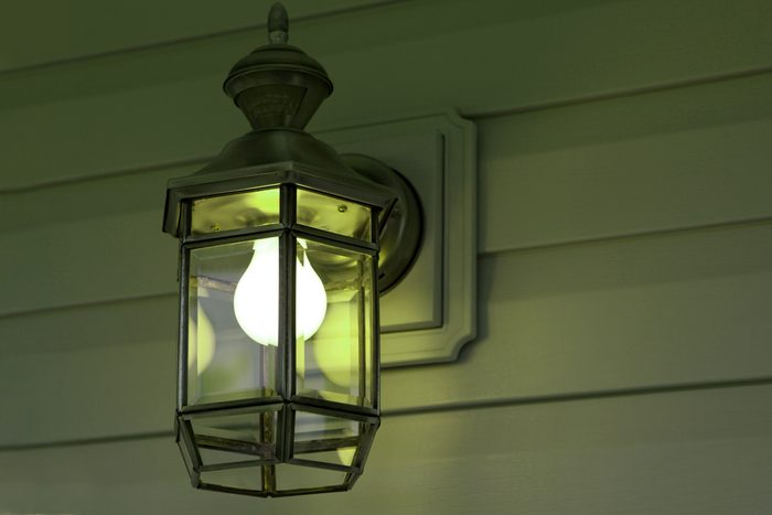 Green Porch Light outside of house
