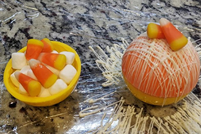 Halloween Hot Cocoa Bombs Inside showing marshmallows and candy corn