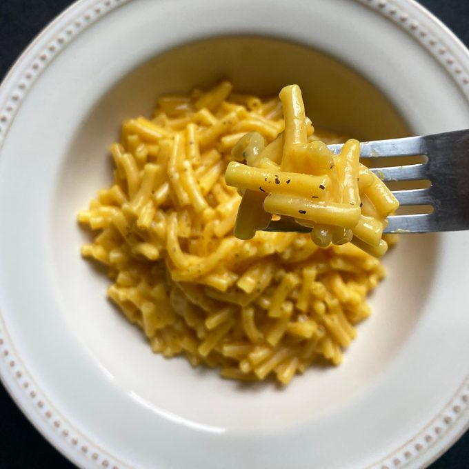 tiktok mac and cheese on fork over bowl